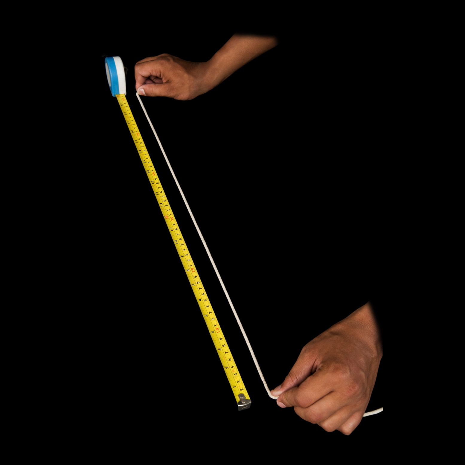 Two hands holding a string agains a tape measure