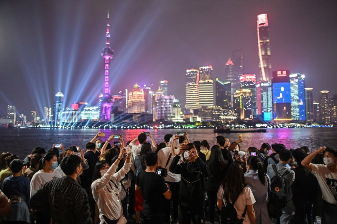 People gather along the Huangpu River for May 1 in Shanghai, China on May 1.