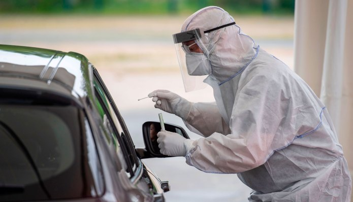 A doctor performs a coronavirus test at a driving test site in Berlin, Germany, April 30.