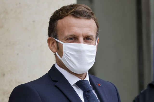 French President Emmanuel Macron looks on as he waits for the arrival of Estonia's Prime Minister before their meeting at the Elysee Palace in Paris on October 28.