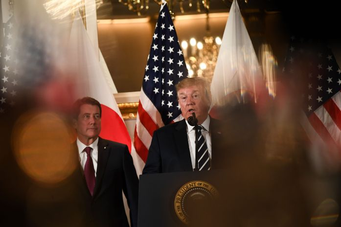 US President Donald Trump (C) speaks during a meeting with business leaders in Tokyo.