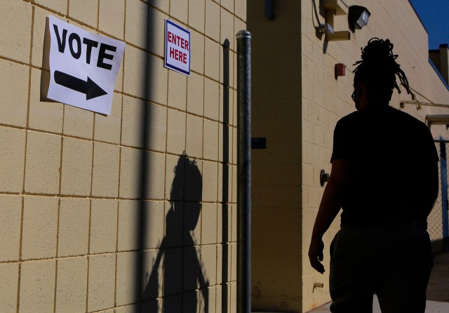 A woman enters a voting station on Election Day at Robert E. Lake Elementary School November 3, in Las Vegas.