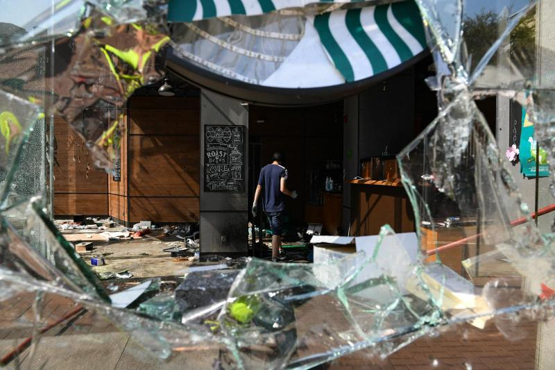 A store which has been vandalized by protesters on Monday in an attempt to distract police from Polytechnic University.