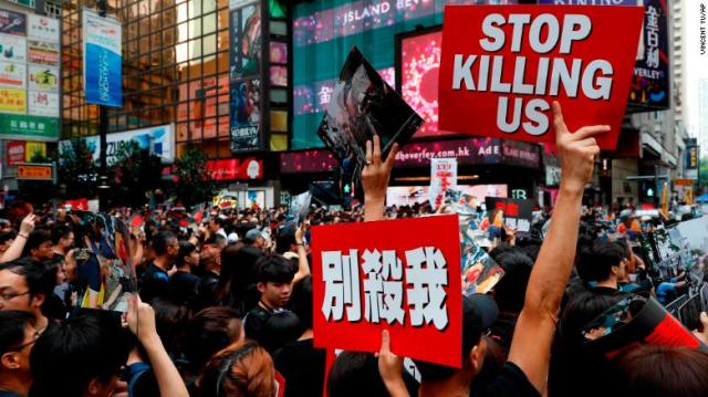 Protesters march on the streets against an extradition bill in Hong Kong on Sunday, June 16.