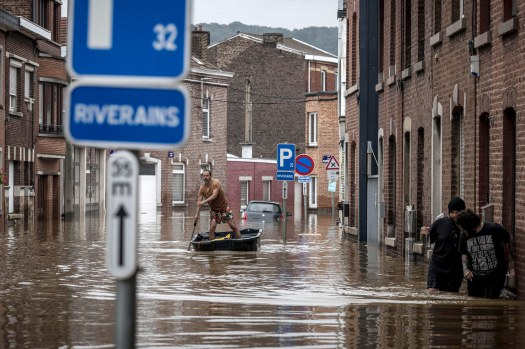 A man rows a boat down a residential street after flooding in Angleur, Province of Liege, Belgium, on July 16.