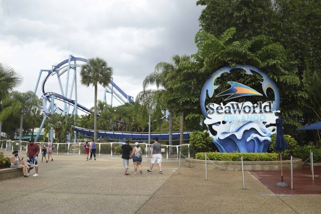 Visitors enter the SeaWorld amusement park in Orlando, Florida, on June 11, following the park's reopening after an almost three-month closure due to the coronavirus pandemic.