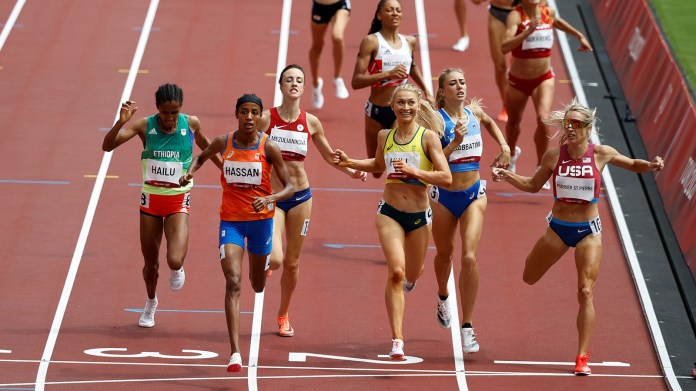 Sifan Hassan crossed the line to finish first during the 1,500-meter heat on Monday.