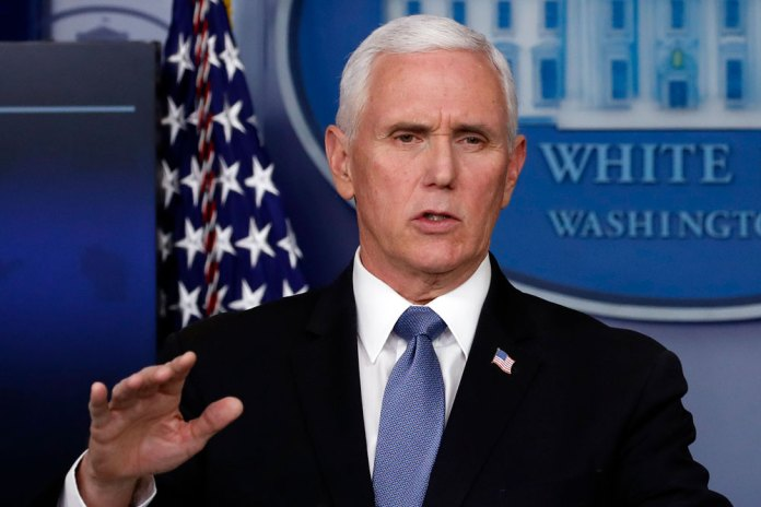 US Vice President Mike Pence talks about the coronavirus at a press conference on Friday.