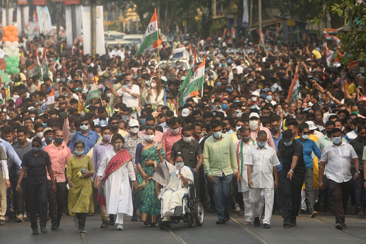 Chief minister of West Bengal and Trinamool Congress leader Mamata Banerjee is seen at the center of an election rally with TMC candidates from Beleghata to Bowbazar on April 15 in Kolkata, India.