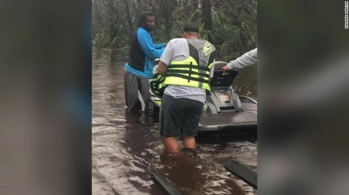 A dozen jet skiers worked together to rescue 100 people on Tuesday.