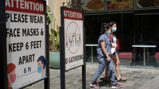 People wear face masks at an outdoor mall in Los Angeles on June 11.