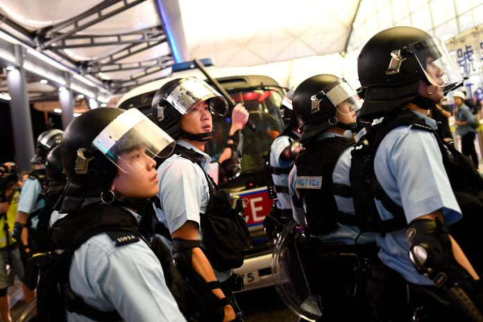 Police secure an airport terminal in Hong Kong after a scuffle with pro-democracy protesters on Aug. 13, 2019.
