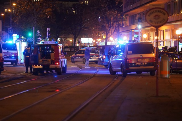 Police cars and ambulances stand in the central Vienna on November 2, following a shooting near a synagogue.