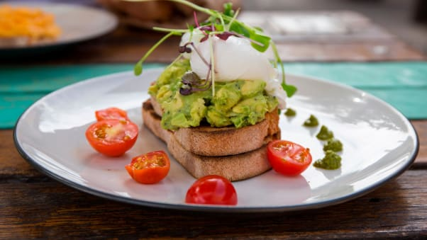Smashed avocado and poached eggs with cherry tomatoes is an Australian original -- a popular option when hungover too.