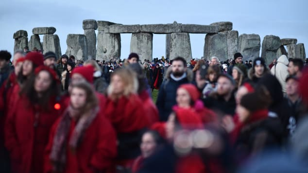 A choir sings at Stonehenge to mark the winter solstice. In-person visits are canceled for 2020, however.