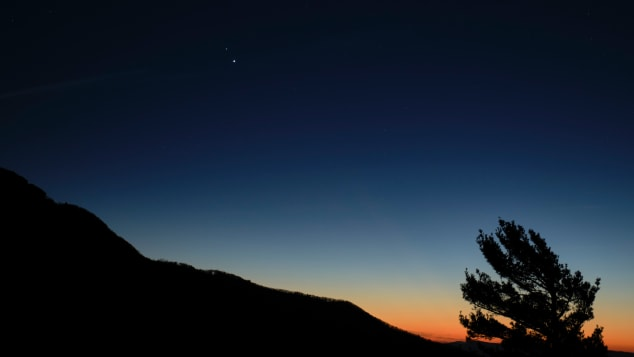 Saturn, top, and Jupiter, below, are seen after sunset on December 13 from Shenandoah National Park in Luray, Virginia.