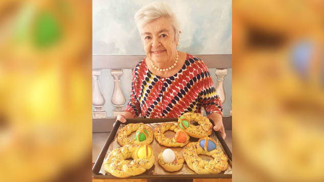 Nonna Romana holds scarcella, a braided Easter bread decorated with colorful hard-boiled eggs. Her granddaughter, Rossella Rago, said Romana made them every Easter for all the kids.