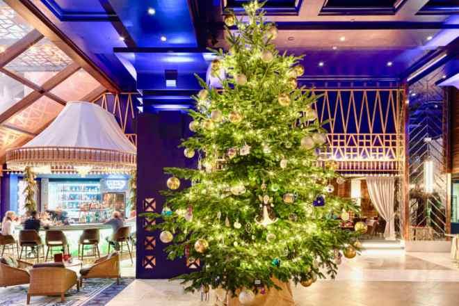 The tree is dripping with diamonds, sapphires and designer jewelry.