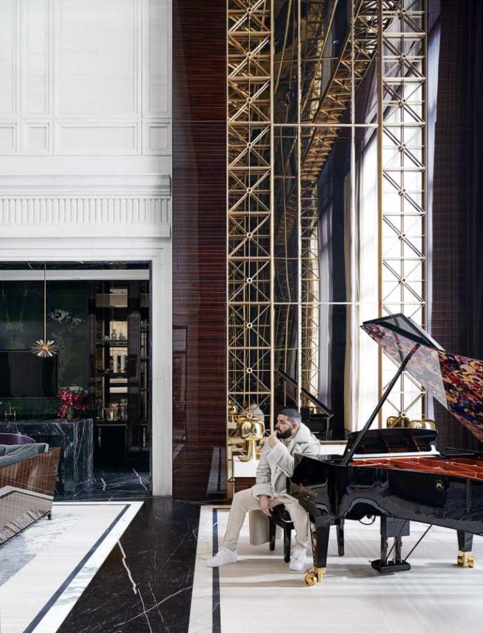Drake in his Toronto home next to a bespoke Bösendorfer concert grand piano, designed by Ferris Rafauli and Takashi Murakami.