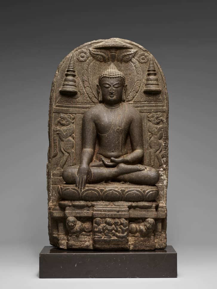 The Buddha triumphing over Mara, a statue in stone from Bihar state, India (approximately 800-900). Part of the Avery Brundage Collection at the Asian Art Museum, San Francisco