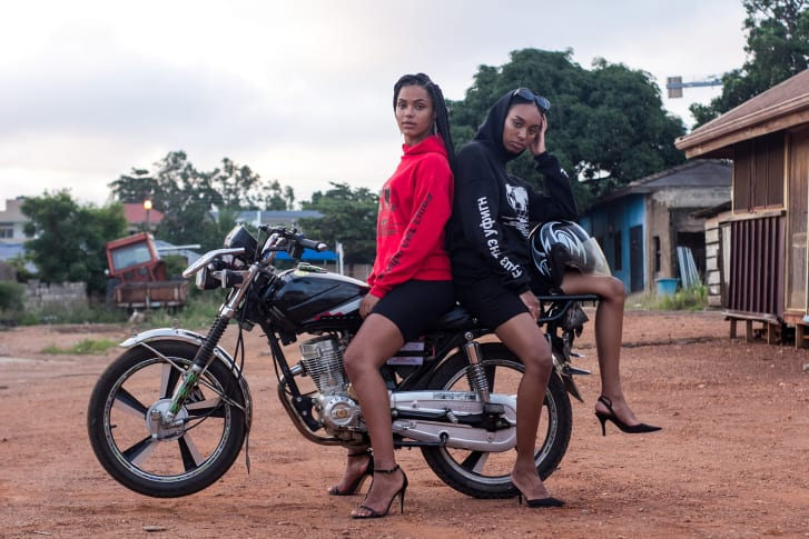 """From Free The Youth's """"Community 1 Collection,"""" worn by models Naa Anowah (in red) and Mecha Clarke (in black)"""
