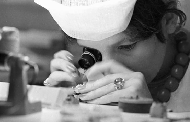 A worker at the Second Moscow Clock factory assembles a watch.