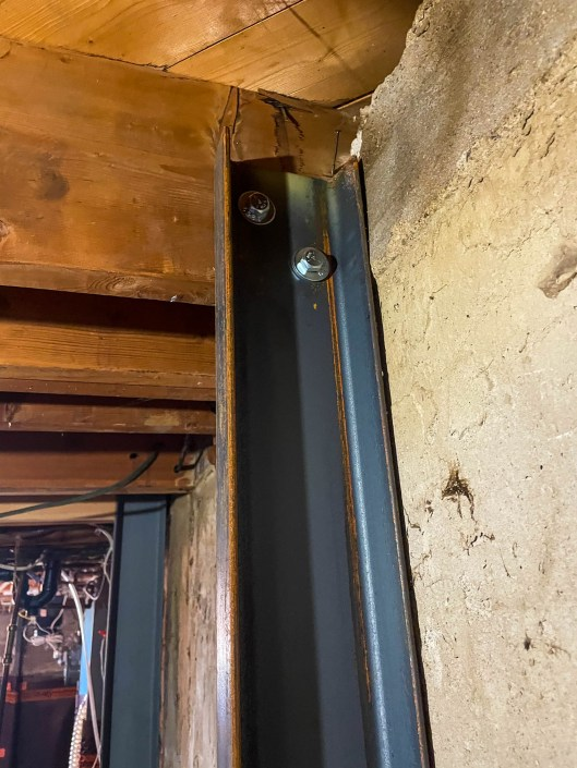 two bolts attach the c channel to the floor joist