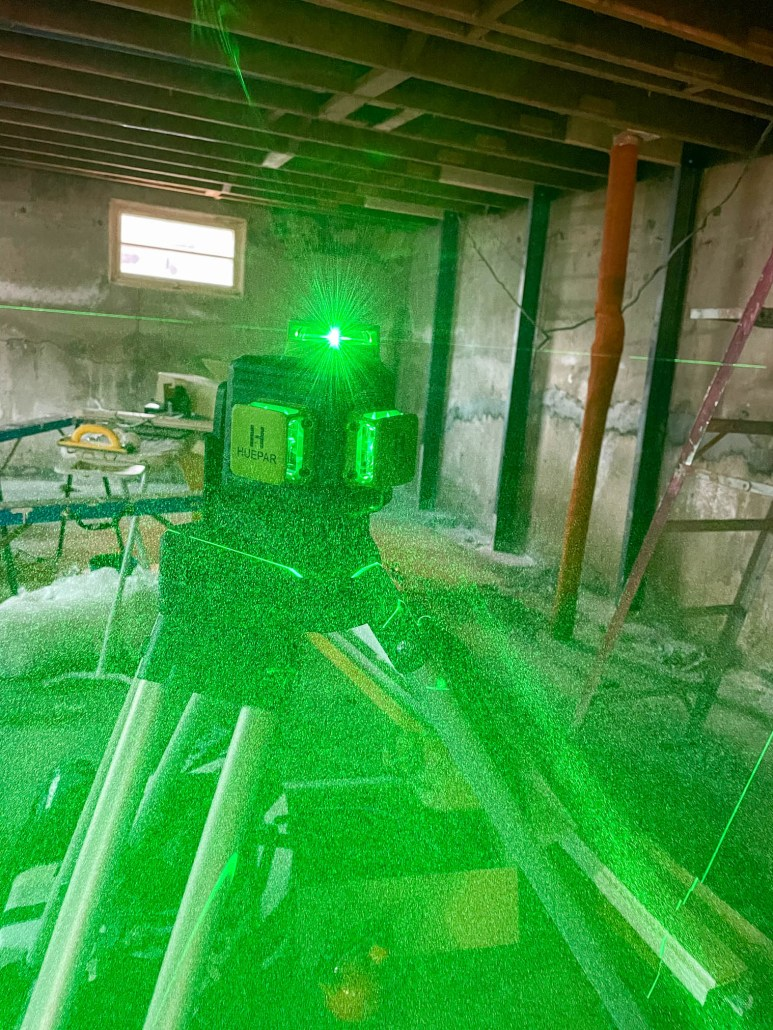 Using a laser level to level a basement