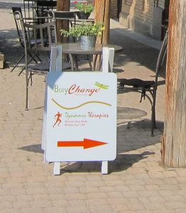 sandwich board sign for BodyChange Pilates Studio and Dynamic Therapies