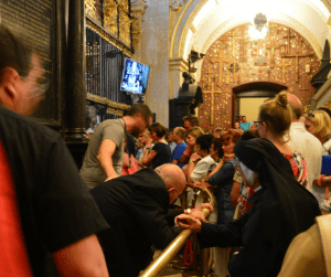 The Black Madonna & the Priest in a Wheelchair