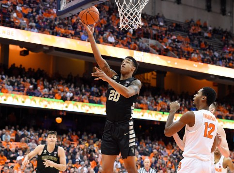 Jan 24, 2017; Syracuse, NY, USA; Wake Forest Demon Deacons forward John Collins (20) shoots the ball as Syracuse Orange forward Taurean Thompson (12) defends during the first half at the Carrier Dome. Mandatory Credit: Rich Barnes-USA TODAY Sports