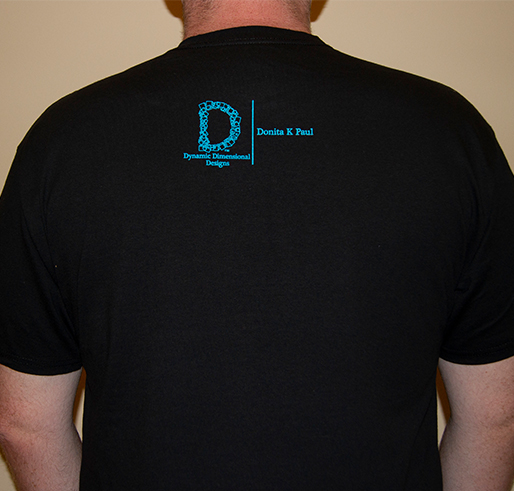 black t shirt with blue lettering saying light up the darkness over a light rock