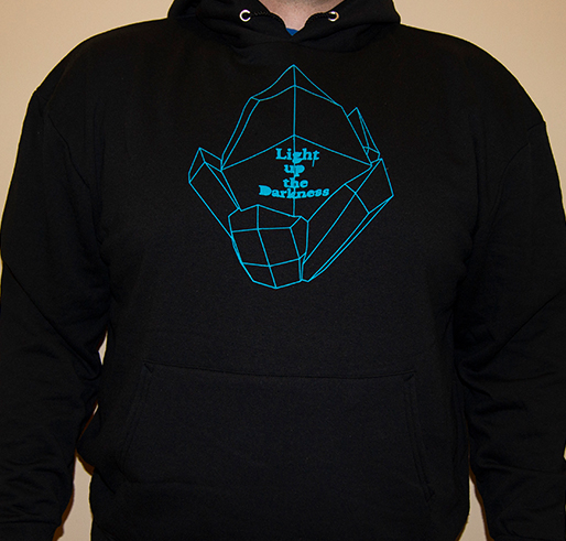 Black hoodie with a blue light rock and the words light up the darkness