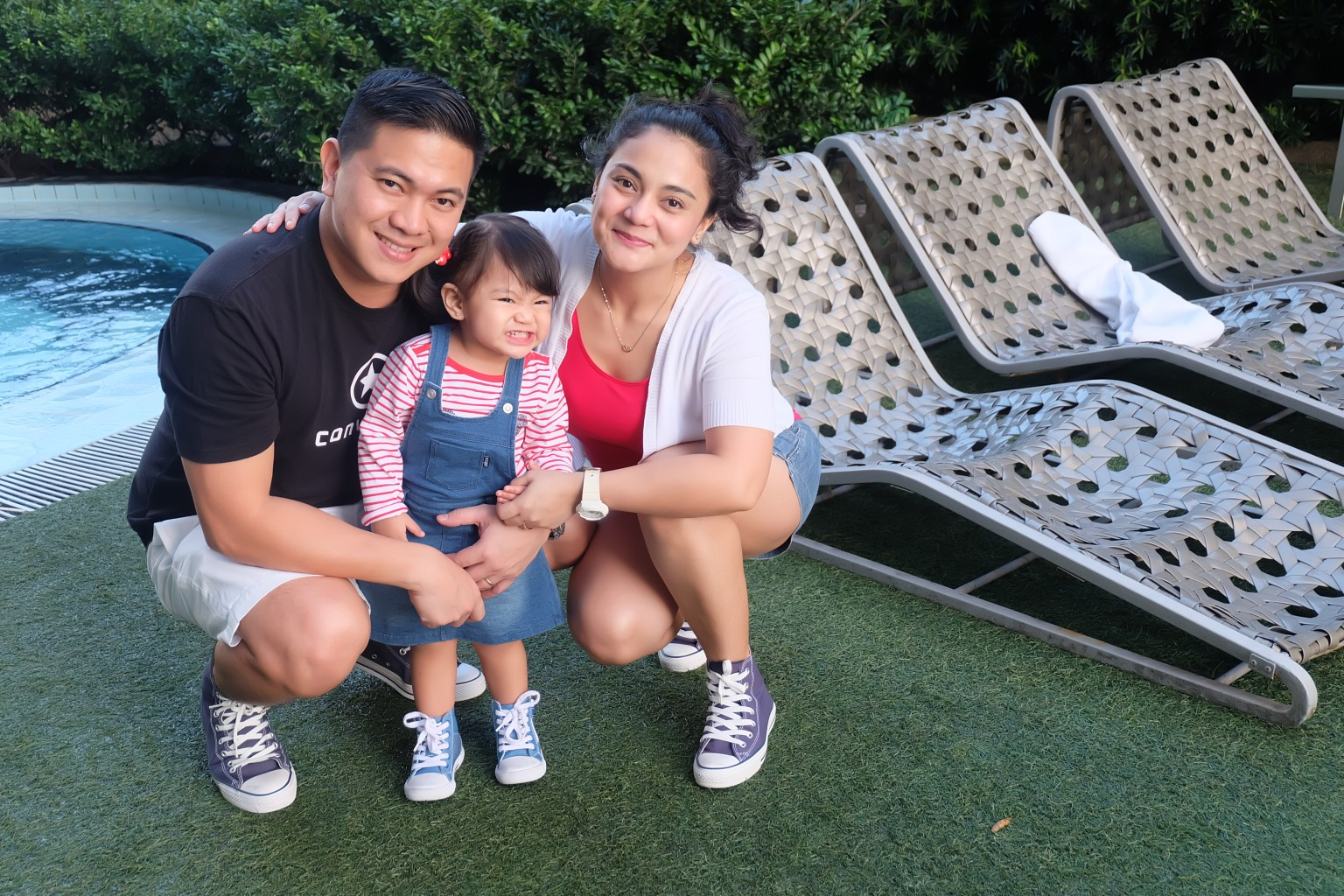 Nish with Hubby and Daughter by the Pool
