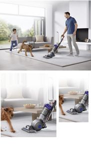 Man, child and dog using Dyson DC66 Animal vacuum cleaner in the living room