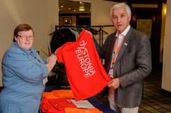 Aileen Dorrian, DE book-keeper selling a Dystonia Europe t-shirt to Dr. Jean-Pierre Lin.