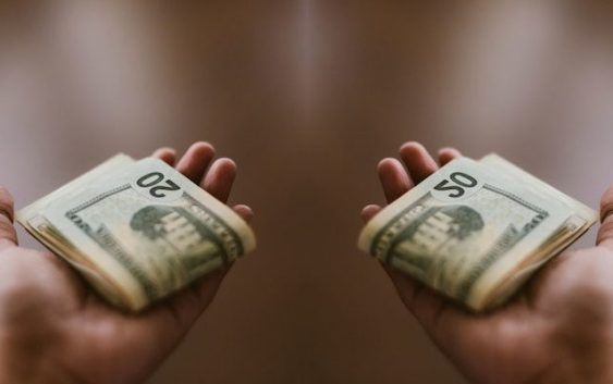 Where does a Christian take money to the church?