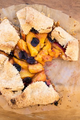 Suncrest and heritage black cherry peach galette with vodka pie crust with cardamom and lemon zest.