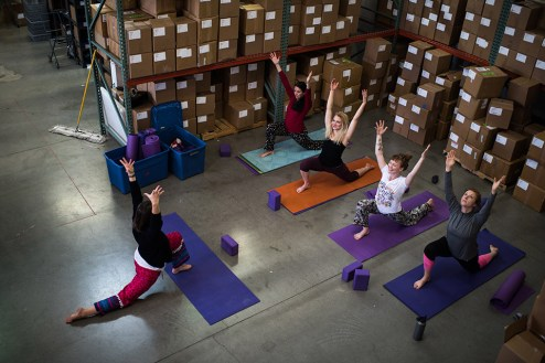 Sundara employee yoga hour in the warehouse