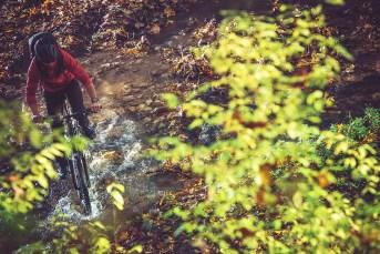 Wilderness Bike Ride. River Crossing on Mountain Bike