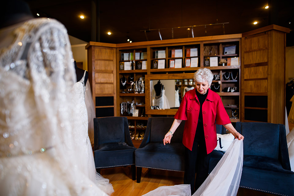 We see Anna working on a few differnt dresses inside her Bridal shop. She will do many alterations here with actual brides in the dresses, and also with dummies.