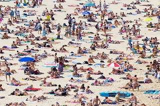 Lots of people tanning at the beach