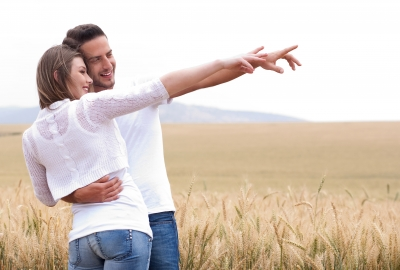 Loving Couple In Field