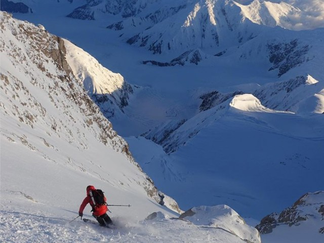 Hilaree skiing down the Messner Couloir on the summit of Denali