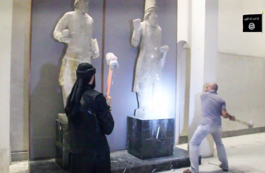ISIS fighters destroying statues in the Mosul Museum
