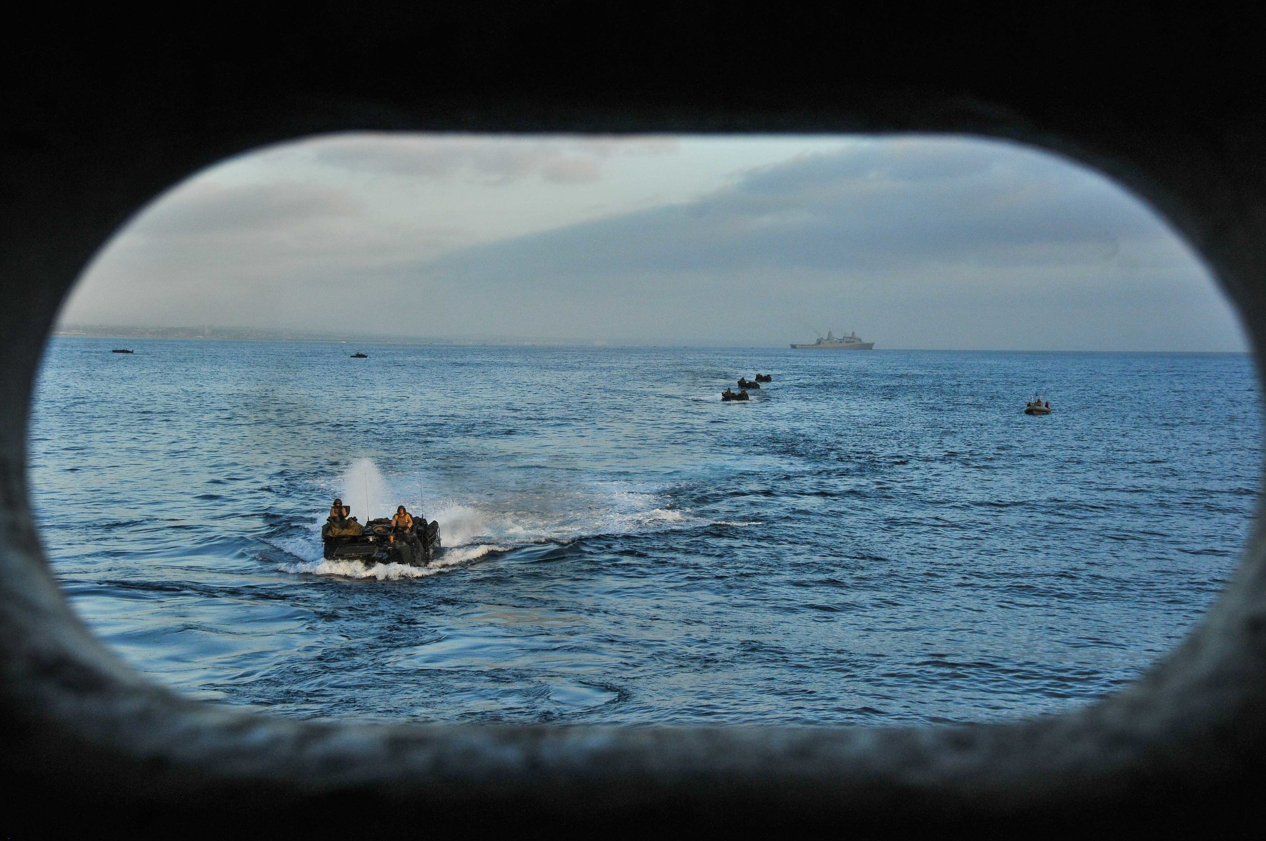 150831-N-WK391-032 PACIFIC OCEAN (August 31,2015) Amphibious assault vehicles prepare to enter the well deck of the amphibious transport dock ship USS New Orleans (LPD 18), during Exercise Dawn Blitz 2015 (DB-15). DB-15, being conducted from Aug. 31- Sept. 9, 2015 by Expeditionary Strike Group 3 (ESG-3) and 1st Marine Expeditionary Brigade (1stMEB), is a multinational training exercise between the U.S., Japan, Mexico and New Zealand which conducts live, simulated, and constructive operations to enhance each country's ability to activate and deploy an Amphibious Task Force with speed and effectiveness in support of the full range of military operations as required by combatant commanders. (U.S. Navy photo by Mass Communications Specialist 3rd Class Brandon Cyr/Released)