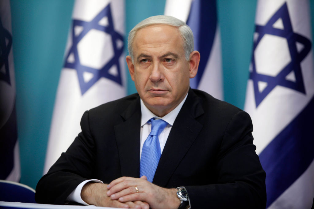 JERUSALEM, ISRAEL - NOVEMBER 21: (ISRAEL OUT) Prime Minister Benjamin Netanyahu looks on during a joint press conference with Foreign Minister Avigdor Liberman and Defence Minister Ehud Barak (not pictured), on November 21, 2012 in Jerusalem, Israel. An official ceasfire started at 9pm local time between Israel and the Palestinian Hamas movement after eight days of conflict resulting in the deaths of over 140 Palestinians, five Israelis and many hundreds injured. (Photo by Lior Mizrahi/Getty Images)