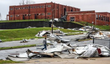 Debris is strewn about the damaged campus of Newnan High School, Friday, March 26, 2022, in Newnan, Ga., the day after a dangerous tornado moved through the area, (John Spink/Atlanta Journal-Constitution via AP)