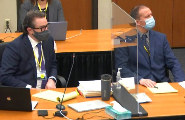 In this image from video, defense attorney Eric Nelson, left, and former Minneapolis police officer Derek Chauvin, right, listen as Judge PeterCahill discusses motions before the court Tuesday, March 30, 2021, in the trial of Chauvin at the Hennepin County Courthouse in Minneapolis, Minn. Chauvin is charged in the May 25, 2020 death of George Floyd. (Court TV via AP, Pool)