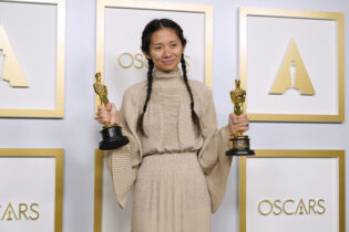 """Chloe Zhao, winner of the awards for best picture and director for """"Nomadland,"""" poses in the press room at the Oscars on Sunday, April 25, 2021, at Union Station in Los Angeles. (AP Photo/Chris Pizzello, Pool)"""
